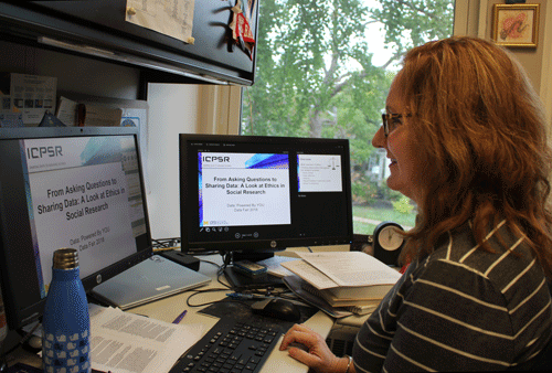 Lynette Hoelter sitting at her desk working on her data fair presentation