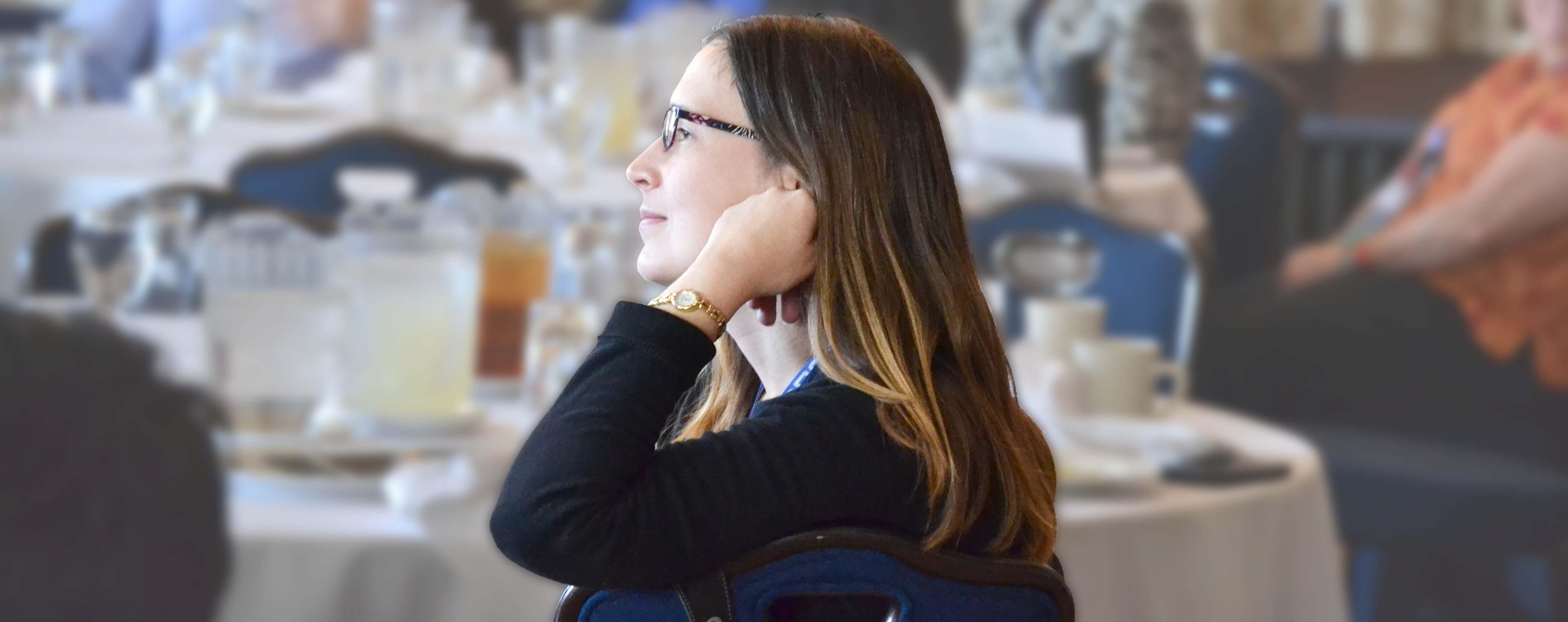 woman sitting at table at O R Meeting